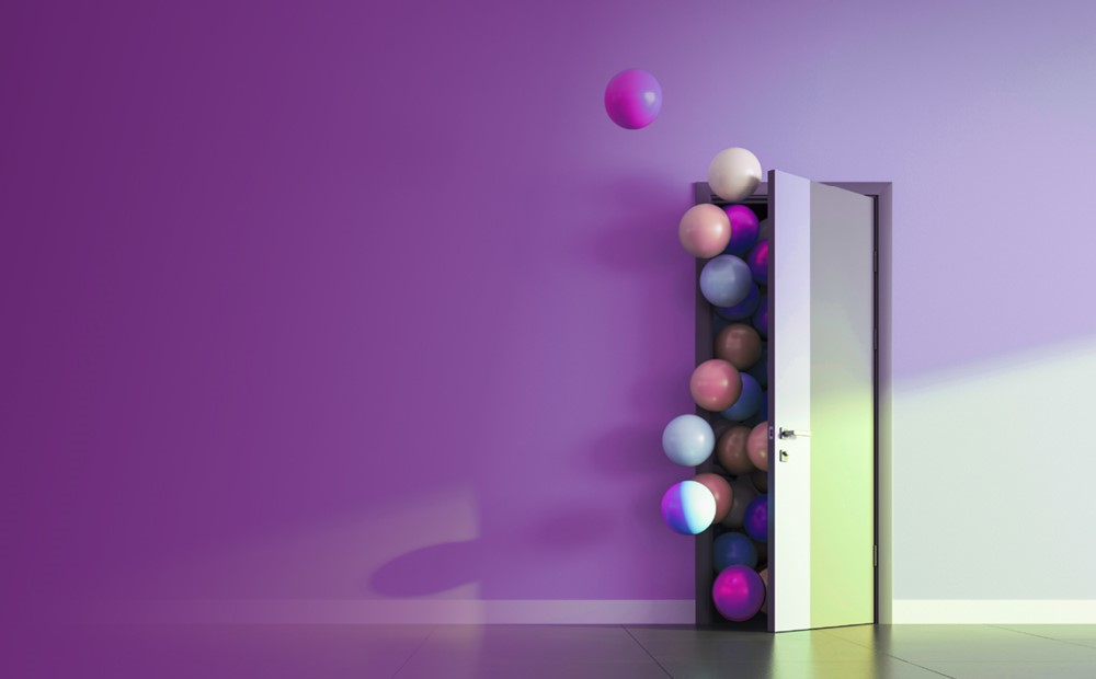Image of balls flowing through a door with a purple background