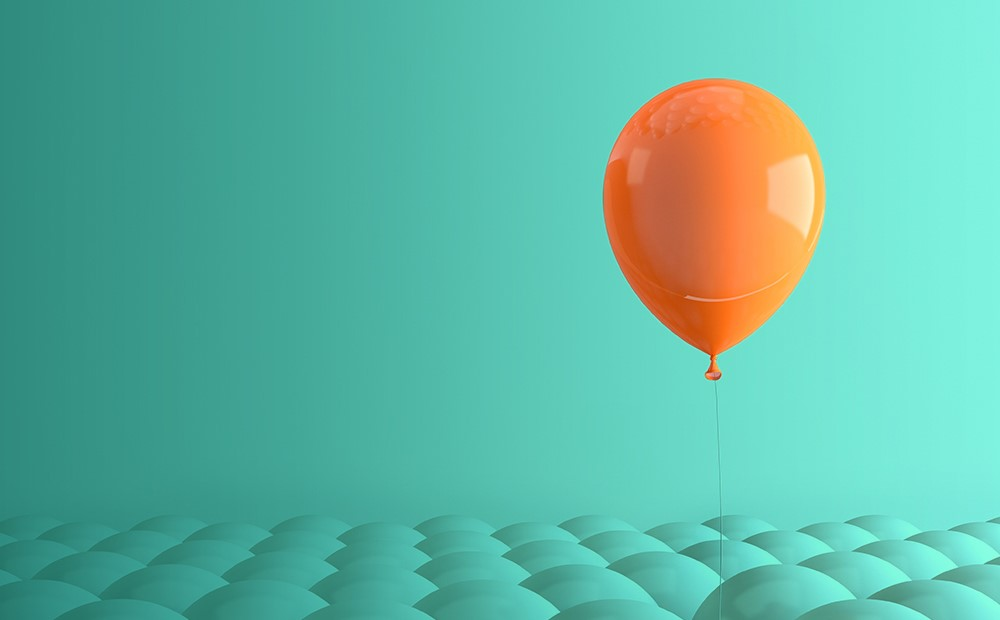 Image of an orange balloon on a teal background